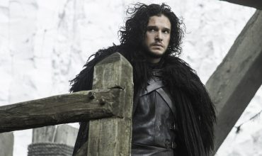 Kit Harington as Jon Snow against the Night's Watch battlements in HBO's Game of Thrones