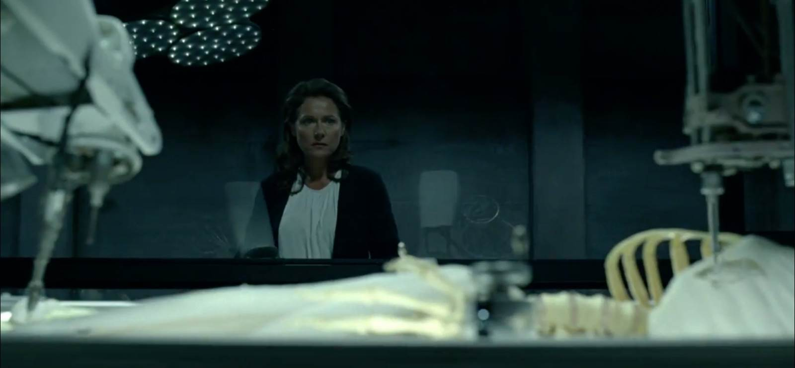 Sidse Babett Knudsen as Theresa Cullen looking at a host's creation in HBO's Westworld