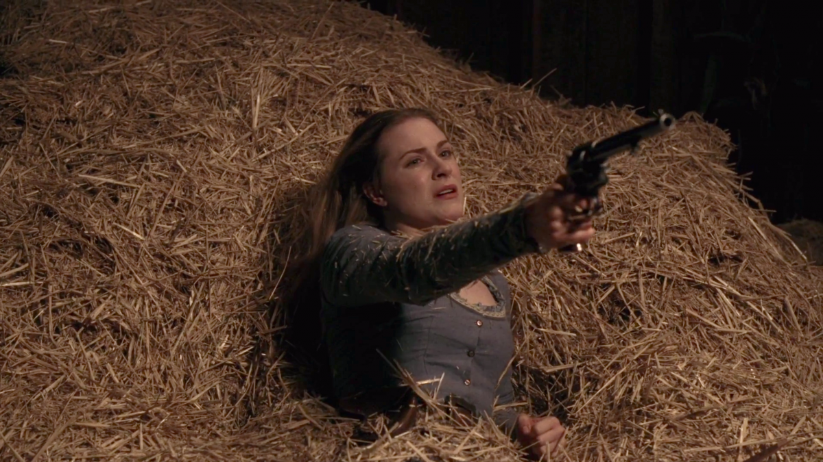 Dolores with gun on Westworld